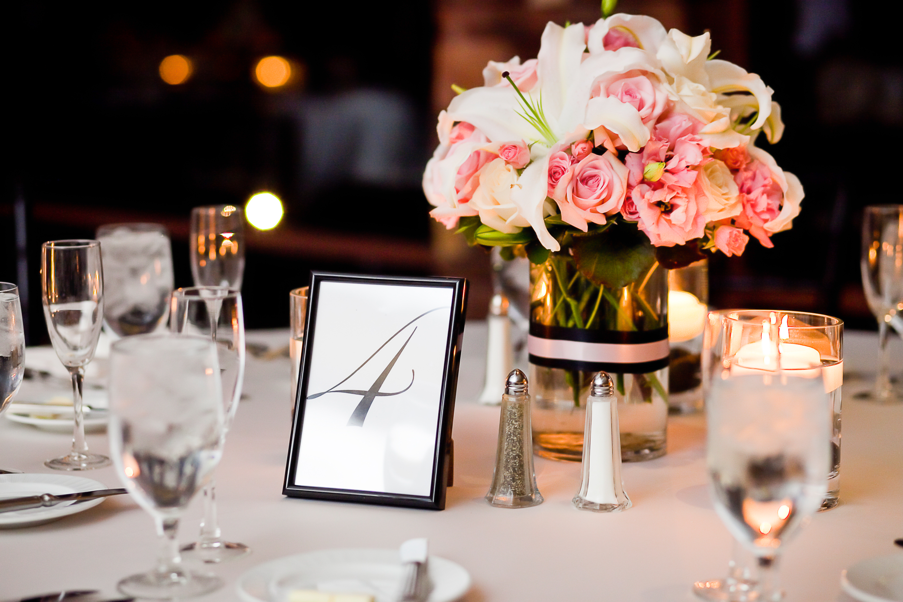 Centerpieces On A Table At Wedding Reception Vouv Dallas Event Venue